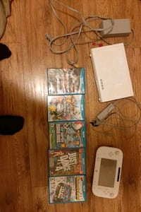 Wii u with 5 games and pro controller Windsor, N9C 2B2