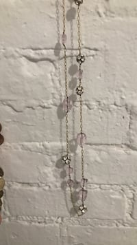 gold-colored and pink beaded link-chain necklace