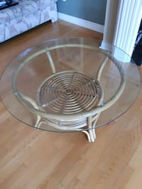 round clear glass top table with stainless steel base