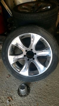 Pick up truck chrome rims and tire.