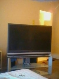 black flat screen TV with brown wooden TV stand Reno, 89512
