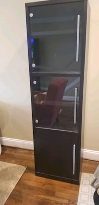 IKEA cabinet with glass and wood doors