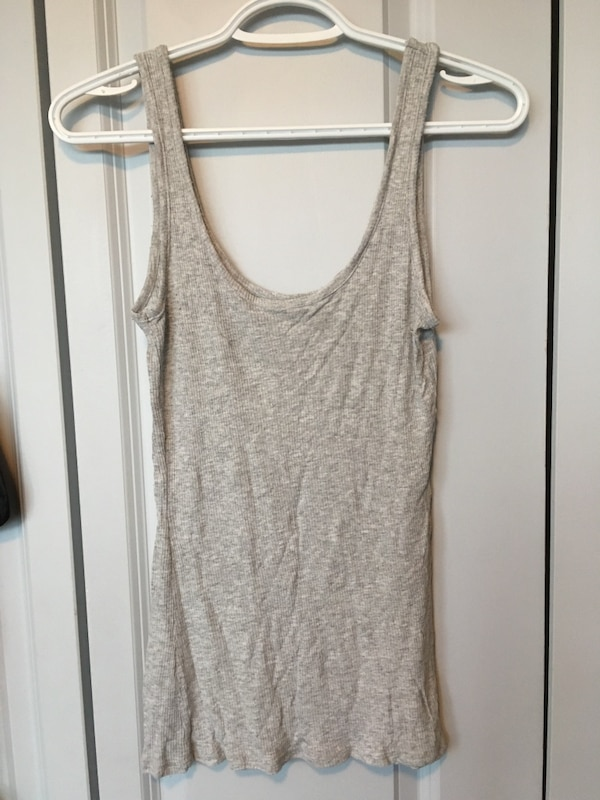 Tanks size small $5 each or 3 for $10 e5d31609-3194-4bd4-af67-6c4652fbd199