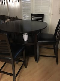 round black wooden table with four chairs dining set Royse City, 75189