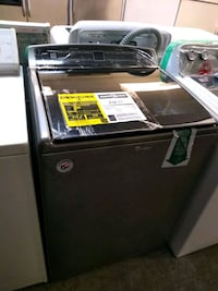 black top-load clothes washer 910 mi