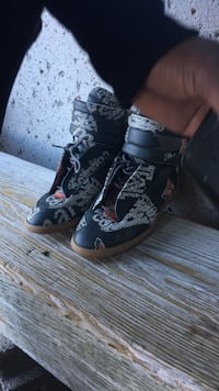 pair of black-and-white high top sneakers Toronto, M2J 4S4