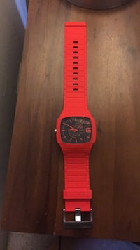 red and black analog watch 24 mi