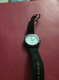 Round black analog watch with black strap Calgary, T2A 4Y9