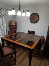 rectangular brown wooden table with six chairs dining set Windsor