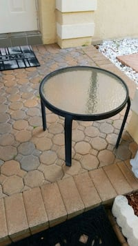 round black metal framed glass top table Coral Springs, 33076