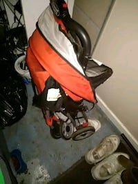 baby's red and black stroller Jackson