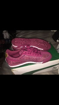 Pair of puma shoes kids size 5.5