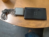 black Nintendo DS with charger null