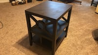 Square brown wooden side table.