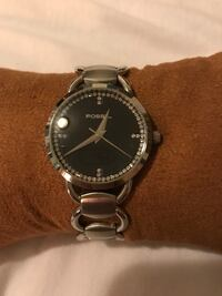 Round faced silver-colored fossil analog watch with link bracelet
