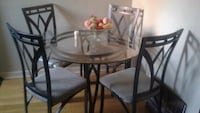Round glass dinning table with four chairs . Brampton, L6S