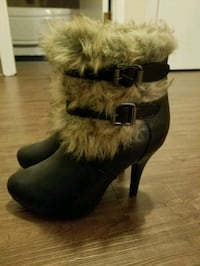 pair of black leather fur-lined stiletto booties