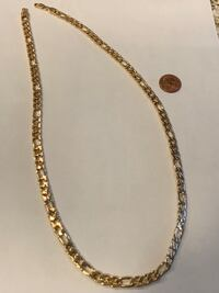 "Gold Figaro necklace 24"" long"