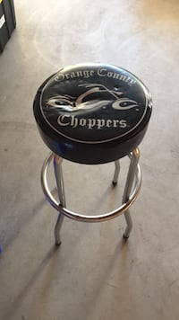 Orange county chopper chair with little rips