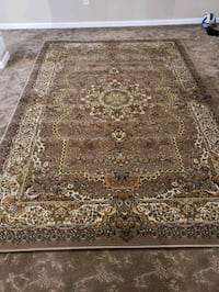 Main color is brown, brand new, 7'by10' Persian style area rug.  New Brighton, 55112