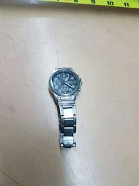 round silver chronograph watch with silver link bracelet Edmonton, T5P 3Y3