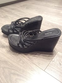 pair of black leather peep-toe wedge sandals