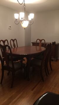 oval brown wooden dining table with chairs set Milton, L9T 2V6
