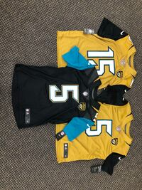 two yellow and blue jersey shirts Jacksonville, 32244