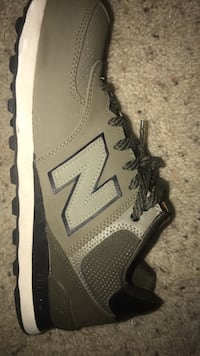 unpaired gray and black New Balance running shoe Arlington, 22204