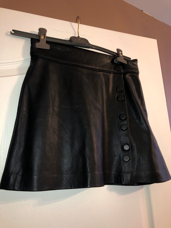 Woman's faux leather skirt with buttons d735ccae-4048-422a-a102-c54093778494