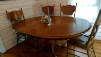 Maple color oak table 4 chairs Monmouth County, 07756