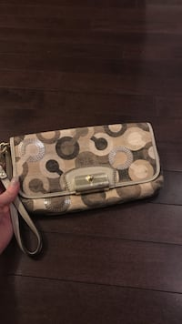 Monogrammed white and brown Coach clutch