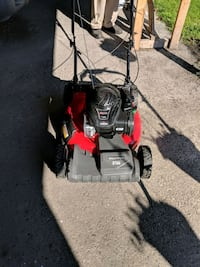 red and black push mower 164 mi