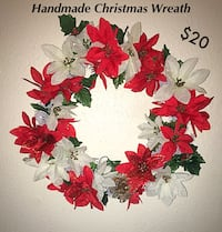 green Christmas-themed garland wreath with flower accent Portsmouth
