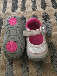 toddler's pair of white shoes