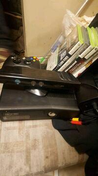 black Xbox 360 console with controller and game cases Sault Ste. Marie, P6A 6M9