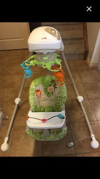 baby's white and green Fisher-Price cradle Airdrie, T4B 0N4