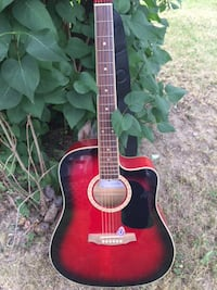 red and black acoustic guitar MONTREAL