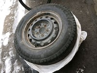 gray bullet hole vehicle wheel and tire set 568 km