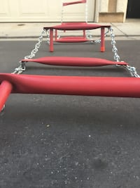 red and gray metal link chain ladder