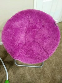 Faux fur saucer chair.
