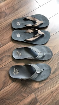 two pairs of black and gray flip flops Vancouver, V6B