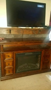 brown wooden framed electric fireplace Elizabethton