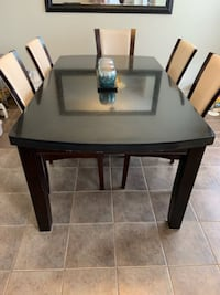 Large Granite Dining Table with 8 chairs. Brampton