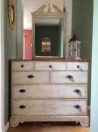 Beautiful dresser done in antique white with dark wax , beautiful top . Solid wood