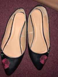 pair of black leather pointed-toe flats Greenville, 29607