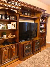 Beautiful high end entertainment center with adjustable tv console  St. Louis, 63108