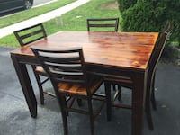 rectangular brown wooden table with four chairs dining set with expanding leaf  Ashburn, 20148