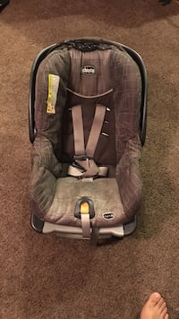 baby's brown Chicco car seat carrier
