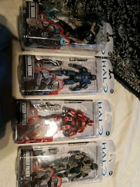four assorted action figures in packs Red Deer, T4P 3K2